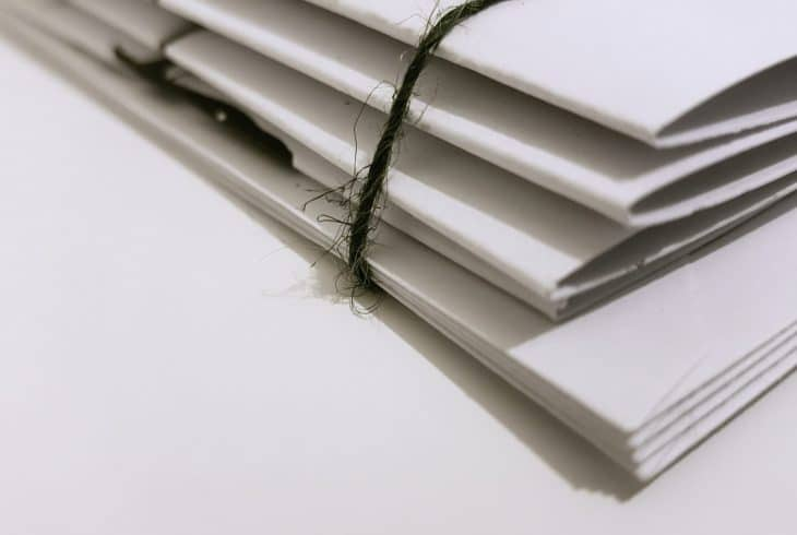 white-paper-folders-with-black-tie-1764956